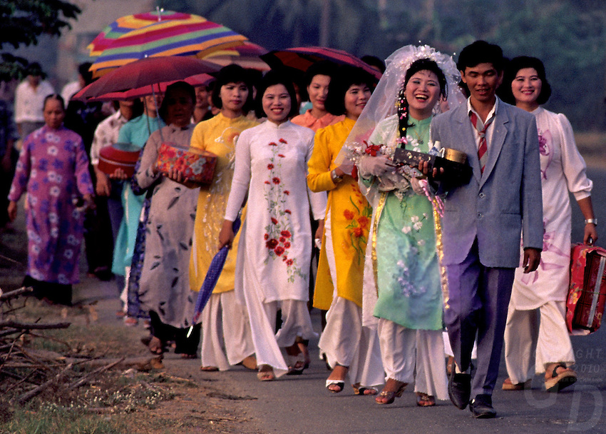 """1992 - A traditional Wedding circa 1992 near Can Tho, the hub of the Mekong Delta (Vietnamese: Đồng bằng Sông Cửu Long """"Nine Dragon river delta""""), also known as the Western Region (Vietnamese: Miền Tây or the South-western region (Vietnamese: Tây Nam Bộ) is the region in southwestern Vietnam where the Mekong River approaches and empties into the sea through a network of distributaries. The Mekong delta region encompasses a large portion of southwestern Vietnam of 39,000 square kilometres (15,000sqmi). The size of the area covered by water depends on the season.<br /> The Mekong Delta has been dubbed as a """"biological treasure trove"""". Over 1,000 animal species were recorded between 1997 and 2007 and new species of plants, fish, lizards, and mammals has been discovered in previously unexplored areas, including the Laotian rock rat, thought to be extinct."""