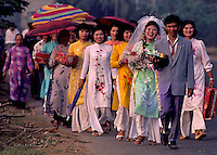 "1992 - A traditional Wedding circa 1992 near Can Tho, the hub of the Mekong Delta (Vietnamese: Đồng bằng Sông Cửu Long ""Nine Dragon river delta""), also known as the Western Region (Vietnamese: Miền Tây or the South-western region (Vietnamese: Tây Nam Bộ) is the region in southwestern Vietnam where the Mekong River approaches and empties into the sea through a network of distributaries. The Mekong delta region encompasses a large portion of southwestern Vietnam of 39,000 square kilometres (15,000 sq mi). The size of the area covered by water depends on the season.<br />