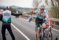 Marcus Burghardt (DEU/BORA - hansgrohe) catching his musette in the feedzone<br /> <br /> Stage 2 from Camaiore to Chiusdino (202km)<br /> <br /> 56th Tirreno-Adriatico 2021 (2.UWT) <br /> <br /> ©kramon