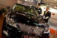 A man cleans a Lexus car in the Guanzhou Luxury Goods Fair in China.