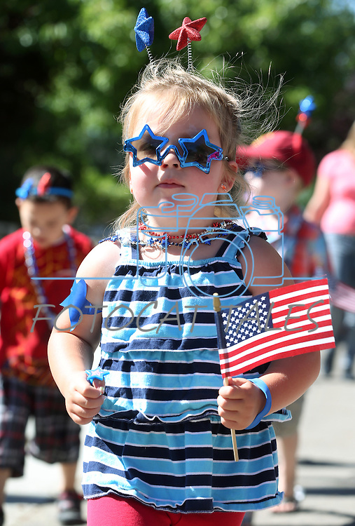 About 40 kids march in the annual Kinderland Nursery School Fourth of July parade in Carson City, Nev., on Thursday, July 3, 2014.<br /> Photo by Cathleen Allison
