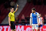 Referee Xavier Estrada Fernandez shows Julian Omar Ramos Suarez, Omar R, of CD Leganes the yellow card during the La Liga 2017-18 match between Atletico de Madrid and CD Leganes at Wanda Metropolitano on February 28 2018 in Madrid, Spain. Photo by Diego Souto / Power Sport Images