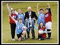 24/02/2009  Copyright Pic: James Stewart.File Name : sct_jspa11_scottis_cup.FORMER FALKIRK LEGEND ALEX TOTTEN SHOWS OFF THE HOMECOMING SCOTLAND SCOTTISH CUP TO (l to r rear) REBECCCA LEWIS, SARAH JOHNSTON, IAN MCARTHUR, ROSS ANDERSON (l to r front) STUART IRVINE AND CAITLIN MUNGALL, PRIMARY SEVEN PUPILS AT ST MARGARET'S PRIMARY SCHOOL, POLMONT......Press Release..... A unique interactive tour to engage primary school children with football and the Homecoming Scottish Cup rolls into town today, Tuesday 24 February 2009 at St Margaret's Primary School in Falkirk.  . .Up to 100 pupils in primaries 5 to 7 at each local school will receive specialist skills and drill training from Scottish Football Association coaches as well as getting the chance to view the Homecoming Scottish Cup trophy itself.. .The school tour takes the form of a giant 'football-shaped' tent, which houses the world's oldest footballing trophy and information about Homecoming Scotland and the Scottish Cup tournament.. .Future football stars will be given soccer skills training ahead of watching their home team, Falkirk, take on Inverness Caledonian Thistle in the quarter finals of the Homecoming Scottish Cup on the weekend of 7 March.. .Falkirk legend Alex Totten, who used to manage the side, will be on hand at St Margaret's Primary School to share his knowledge and experience with the kids and to see the trophy himself.. .All primary schools in Scotland will also be sent education packs to encourage pupils to know more about Homecoming Scotland and to learn more about healthy eating, fitness and playing football as a way to keep fit and have fun.  . .As part of the football celebrations, the tour will then encourage locals in the town centre to get behind their local team, when the cup visits The Mall in Falkirk later in the afternoon.. .The Homecoming Scottish Cup Tour has been designed to engage with Scotland's local communities and spread the message about joining in the celebrations for Homecomi