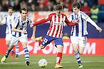 Atletico de Madrid's LucianoVietto (c) and Real Sociedad's Mikel Gonzalez (l) and Aritz Elustondo during La Liga match. March 1,2016. (ALTERPHOTOS/Acero)