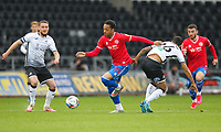 20th April 2021; Liberty Stadium, Swansea, Glamorgan, Wales; English Football League Championship Football, Swansea City versus Queens Park Rangers; Chris Willock of Queens Park Rangers evades the challenge from Kyle Naughton of Swansea City
