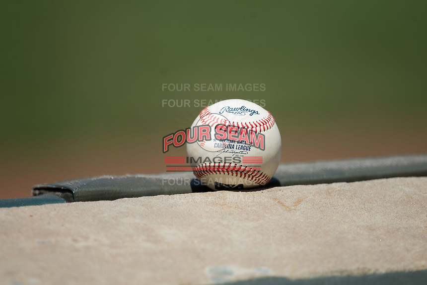 A Rawlings Carolina League baseball sits on the wall during the game between the Salem Red Sox and the Winston-Salem Dash at BB&T Ballpark on July 23, 2017 in Winston-Salem, North Carolina.  The Dash defeated the Red Sox 11-10 in 11 innings.  (Brian Westerholt/Four Seam Images)