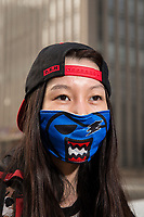 Ms. Wang (37), an office worker in Beijing, wears a distinctive blue mask that she uses for skiing and doubles in purpose to protect her from air pollution. PM2.5 reading - 170 - Unhealthy