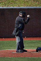 The home plate umpire makes a strike call during the NCAA D2 baseball game between the Concord Mountain Lions and the Wingate Bulldogs at Ron Christopher Stadium on February 2, 2020 in Wingate, North Carolina. The Mountain Lions defeated the Bulldogs 12-11. (Brian Westerholt/Four Seam Images)