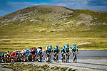 The peloton led by Astana Pro Team pass through stunning scenery during Stage 3 of the 2018 Artic Race of Norway, running 194km from Honningsvg to Hammerfest, Norway. 18th August 2018. <br /> <br /> Picture: ASO/Pauline Ballet | Cyclefile<br /> All photos usage must carry mandatory copyright credit (© Cyclefile | ASO/Pauline Ballet)