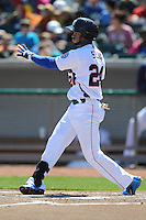 Tennessee Smokies right fielder Rubi Silva #24 swings at a pitch during a game against Chattanooga Lookouts at Smokies Park on April 10, 2014 in Kodak, Tennessee. The Lookouts defeated the Smokies 1-0. (Tony Farlow/Four Seam Images)