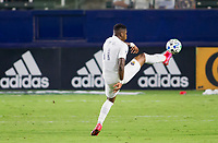 CARSON, CA - OCTOBER 07: Yony Gonzalez #11 of the Los Angeles Galaxy reaches for a ball during a game between Portland Timbers and Los Angeles Galaxy at Dignity Heath Sports Park on October 07, 2020 in Carson, California.