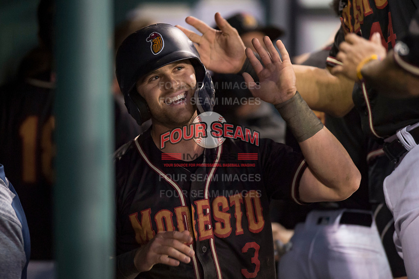 Modesto Nuts designated hitter Logan Taylor (3) is congratulated by teammates after scoring a run during a California League game against the Lake Elsinore Storm at John Thurman Field on May 11, 2018 in Modesto, California. Modesto defeated Lake Elsinore 3-1. (Zachary Lucy/Four Seam Images)