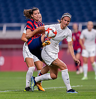 SAITAMA, JAPAN - JULY 24: Tobin Heath #7 of the USWNT is defended by Abby Erceg #8 of New Zealand during a game between New Zealand and USWNT at Saitama Stadium on July 24, 2021 in Saitama, Japan.