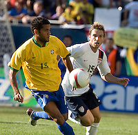 Daniel Alves runs with the ball as Bobby Convey closes during a USA vs Brazil international friendly which Brazil won, 4-2, at Soldier Field, Chicago, IL on September 9, 2007.
