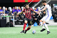 ATLANTA, GA - MARCH 07: ATLANTA, GA - MARCH 07:  Jake Mulraney and Mathieu Deplagne contest for the ball during the match against Atlanta United, which Atlanta won, 2-1, in front of a crowd of 69,301 at Mercedes-Benz Stadium during a game between FC Cincinnati and Atlanta United FC at Mercedes-Benz Stadium on March 07, 2020 in Atlanta, Georgia.