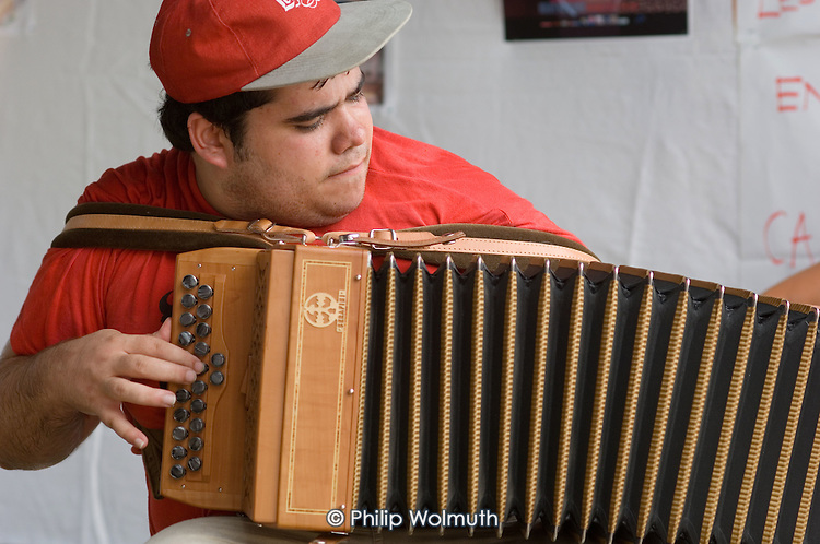 An accordionist plays at the 31st International Festival of Luthiers and Maitres Sonneurs, in Saint Chartier, France.