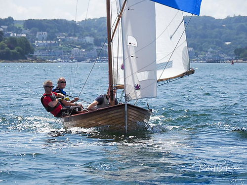 Summertime. Derek Joyce of Wexford racing his Mermaid No 187 at Mermaid Week 2019 in Crosshaven. It was experience of Mermaid Week 1972 in Wexford which first started Galway Bay SC on the high road to hosting this major event in 1982 at their new clubhouse at Renville near Oranmore Photo: Robert Bateman