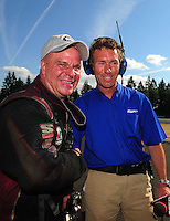 Aug. 7, 2011; Kent, WA, USA; NHRA funny car driver Tim Wilkerson (left) celebrates with NHRA Announcer Whit Bazemore after winning the Northwest Nationals at Pacific Raceways. Mandatory Credit: Mark J. Rebilas-
