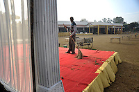 A worker sweeps a platform at Grewal Farms, one of many wedding reception centres in Amritsar which employs hundreds of staff during the wedding season to work around the clock hosting day and night marriage ceremonies and parties.