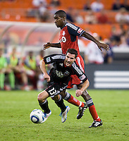 Chris Pontius (13) of D.C. United is fouled by Andy Iro (3) of Toronto FC during the game at RFK Stadium in Washington, DC.  D.C. United tied Toronto FC, 3-3.