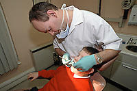 Young child having his teeth examined by a dentist during a regular dental check up appointment. This image may only be used to portray the subject in a positive manner..©shoutpictures.com..john@shoutpictures.com