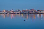 Portland Maine at dawn from Portland Breakwater Light Park in Portland, Maine USA during the spring months.
