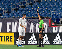 FOXBOROUGH, MA - SEPTEMBER 1: Referee Anya Voigt shows the yellow card to Luca Mastrantonio #4 of FC Tucson during a game between FC Tucson and New England Revolution II at Gillette Stadium on September 1, 2021 in Foxborough, Massachusetts.