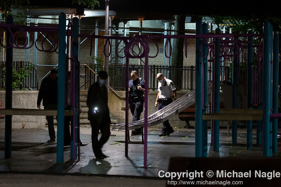 The NYPD investigates a double shooting at the Atlantic Terminal Houses at 487 Carlton Ave. (NYCHA) on July 18, 2020 in the Clinton Hill neighborhood of the Brooklyn borough of New York City.  Photograph by Michael Nagle