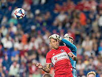 FOXBOROUGH, MA - AUGUST 25: Matt Turner #30 of New England Revolution punches ball away from Francisco Calvo #5 of Chicago Fire during a game between Chicago Fire and New England Revolution at Gillette Stadium on August 24, 2019 in Foxborough, Massachusetts.