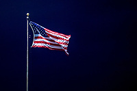 29 August 2019: The American Flag flies over the center field fence during a Single-A minor league game between the Connecticut Tigers and the Vermont Lake Monsters at Centennial Field in Burlington, Vermont. The Tigers defeated the Lake Monsters 6-2 in the first game of their NY Penn League double-header.  Mandatory Credit: Ed Wolfstein Photo *** RAW (NEF) Image File Available ***