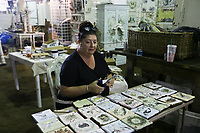 Stayci Bradford of Granbury, Texas prepares her custom tiles at her booth called Tin Can Gypsy, Thursday, October 7, 2021 at the Benton County Fairgrounds in Bentonville. The annual Vintage Market days makes its return to the fairgrounds featuring dozens of vendors selling vintage-inspired goods. The market will run through the weekend. Check out nwaonline.com/211008Daily/ for today's photo gallery. <br /> (NWA Democrat-Gazette/Charlie Kaijo)