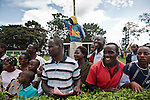 Fans in the Silver Ring at the Ngong Racecourse excitedly watch the horses near the finish of a race.