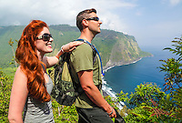 Hikers enjoy sea views from an overlook along the road into Waipi'o Valley, Big Island of Hawai'i.