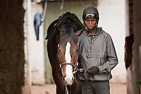 Patrick Mungai, jockey at Ngong Race Course in Naiorbi, Kenya. The horse is named Russian Survivor