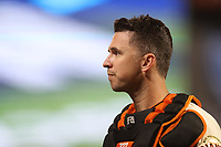SAN FRANCISCO, CA - OCTOBER 9:  Buster Posey #28 of the San Francisco Giants walks off the field in between innings against the Los Angeles Dodgers during Game 2 of the NLDS at Oracle Park on Saturday, October 9, 2021 in San Francisco, California. (Photo by Brad Mangin)