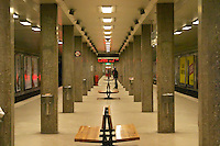The Stockholm underground subway Tunnelbanan Tunnelbana an empty platform at the station Radmansgatan with a man standing in the distance and concrete pillars publicity posters on the walls Stockholm, Sweden, Sverige, Europe