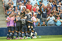 KANSAS CITY, KS - JUNE 26: Sporting KC players and fans celebrate the game tying goal during a game between Los Angeles FC and Sporting Kansas City at Children's Mercy Park on June 26, 2021 in Kansas City, Kansas.