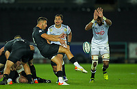 8th October 2021;  Swansea.com Stadium, Swansea, Wales; United Rugby Championship, Ospreys versus Sharks; Rhys Webb of Ospreys clears the ball while under pressure from Hyron Andrews of Cell C Sharks