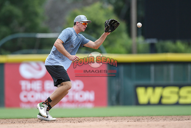 """Logan Davidson of the Oakland Athletics works on defense in a """"Sandlot""""-style game concluding a series of workouts with local MLB and MiLB players from around the Upstate region on Thursday June 25, 2020, at Fluor Field at the West End in Greenville, South Carolina. (Tom Priddy/Four Seam Images)"""