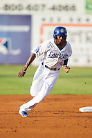 Darnell Sweeney (9) of the Chattanooga Lookouts hustles towards third base against the Montgomery Biscuits at AT&T Field on July 24, 2014 in Chattanooga, Tennessee.  The Biscuits defeated the Lookouts 6-4. (Brian Westerholt/Four Seam Images)