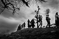 Albanian refugees leave the woods below Gajre where they had been hiding for three days from Serb shelling of their villages. UNHCR moved them to a safer place in the village of BOB. 02/03/99
