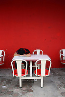 A restaurant worker sleeps next to a bright red wall.<br /> <br /> To license this image, please contact the National Geographic Creative Collection:<br /> <br /> Image ID: 1588098 <br />  <br /> Email: natgeocreative@ngs.org<br /> <br /> Telephone: 202 857 7537 / Toll Free 800 434 2244<br /> <br /> National Geographic Creative<br /> 1145 17th St NW, Washington DC 20036