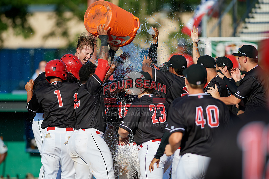 Batavia Muckdogs center fielder Brayan Hernandez (18) is congratulated by his teammates after hitting a game winning grand slam in the bottom of the ninth inning during a game against the West Virginia Black Bears on July 1, 2018 at Dwyer Stadium in Batavia, New York.  Batavia defeated West Virginia 8-4.  (Mike Janes/Four Seam Images)