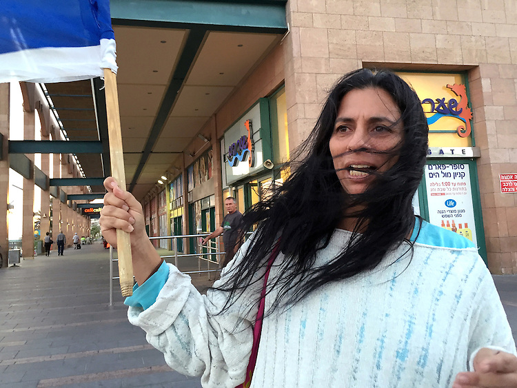 "7. ""Protestor with Israeli flag"": agitating for more government protection against terrorism, Eilat.<br />