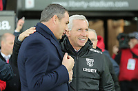 (L-R) Swansea manager Paul Clement greets West Bromwich Albion manager Alan Pardew  during the Premier League match between Swansea City and West Bromwich Albion at The Liberty Stadium, Swansea, Wales, UK. Saturday 09 December 2017
