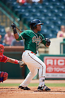 Greensboro Grasshoppers right fielder Isael Soto (15) follows through on a swing during a game against the Lakewood BlueClaws on June 10, 2018 at First National Bank Field in Greensboro, North Carolina.  Lakewood defeated Greensboro 2-0.  (Mike Janes/Four Seam Images)