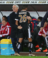 Leicester City manager Claudio Ranieri celebrates with Riyad Mahrez after he is substituted during the Barclays Premier League match between Swansea City and Leicester City played at The Liberty Stadium on 5th December 2015