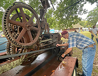 Preston Mayes fires up the 1-cylinder engine on a can crusher Sunday Sept. 6, 2021 during the 2021 Prairie Grove Clothesline Fair at the Prairie Grove Battlefield State Park. Mayes built the crusher out of a stationary hay bailer from the 1930s. The Prairie Grove Clothesline Fair is held at the Prairie Grove Battlefield Park over the Labor Day Weekend each year. The fair is a partnership between the Prairie Grove Battlefield Park and the Prairie Grove Lions Club. Visit nwaonline.com/210000906Daily/  (NWA Democrat-Gazette/J.T. Wampler)