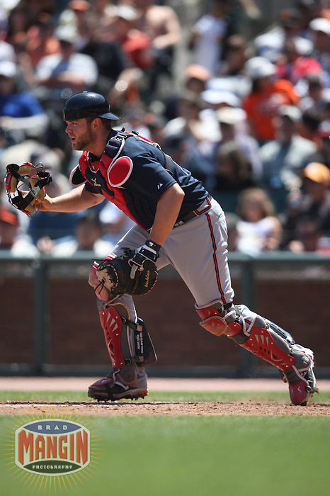 SAN FRANCISCO - MAY 25:  Brian McCann #16 of the Atlanta Braves chases a bunt against the San Francisco Giants during the game at AT&T Park on May 25, 2009 in San Francisco, California. Photo by Brad Mangin