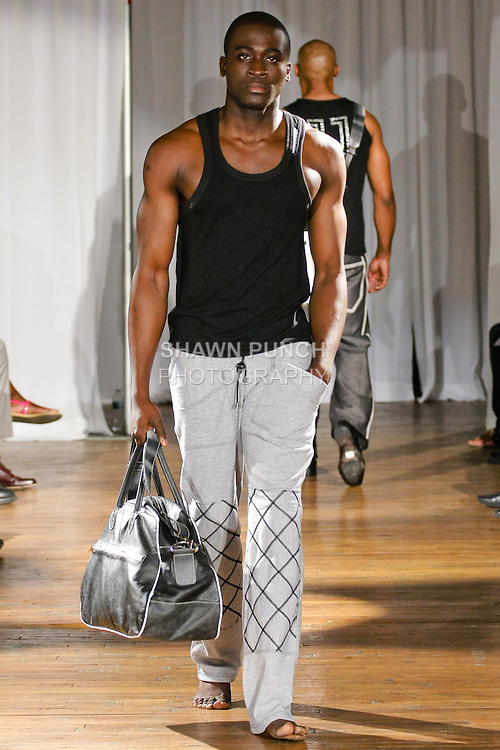 Model walks the runway in a Jair Trujillo outfit, during the Ray Vincente Menswear Showcase 2010 fashion show at Chacala Loft on June 18, 2010.